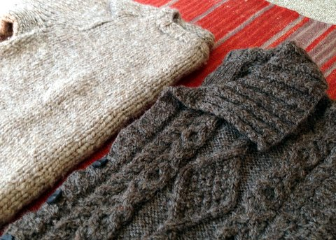 Two sweaters spun from Shetland roving from Sheep Street Fibers. Sweater on left is my first handknit sweater, weighing nearly two pounds. I spun and knit the sweater on left years later. It weighs just over one pound.